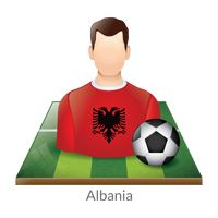 Albania player with soccer ball on field