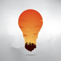 Double exposure of bulb and cityscape