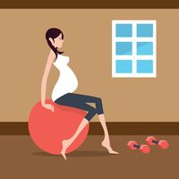Pregnant woman exercising with exercise ball