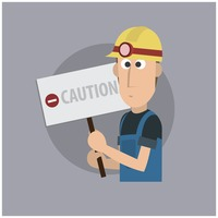 Worker with caution board