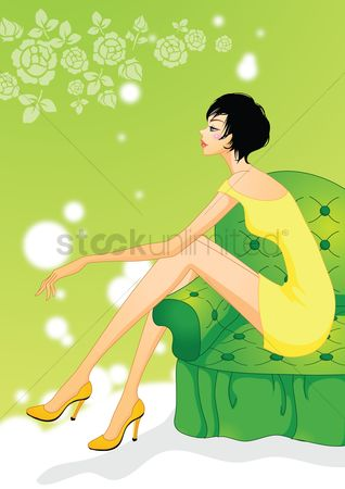 Interior : Fashionable woman sitting on sofa