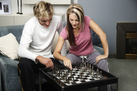 A couple playing chess game