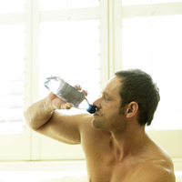 A man drinking water after working out