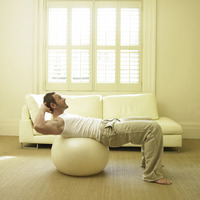 A man exercising with fitness ball
