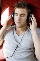 A man listening to music by headphone