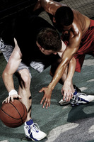 A player trying to snatch the ball from his opponent