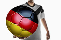 A soccer player holding germany soccer ball