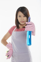 Angry woman holding out a spray bottle
