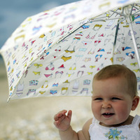 Baby girl with umbrella shielding her