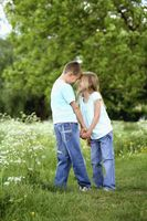Boy and girl holding hands in the park