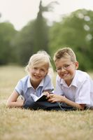 Boy and girl studying together in the park
