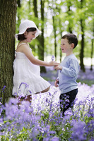 Boy giving girl flower
