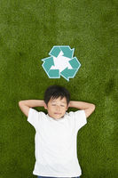 Boy lying on the grass with eyes closed
