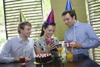 Business people celebrating colleague's birthday