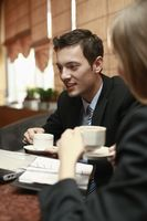Business people enjoying coffee