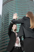 Business people giving high-five to each other