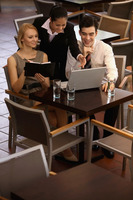 Business people having discussion in a cafe