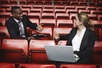 Business people having discussion in a stadium
