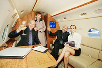 Business people in a private jet