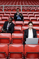 Business people in the stadium
