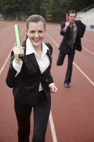 Business people running in a relay