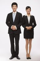 Businessman and businesswoman smiling