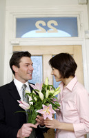 Businessman bringing home a bouquet of flowers for his wife