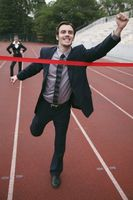 Businessman crossing the finishing line
