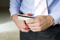 Businessman cutting credit card