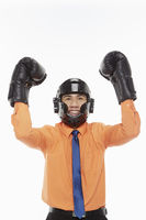 Businessman dressed with boxing gear, cheering
