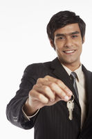 Businessman handing out a set of keys