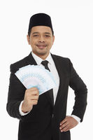 Businessman holding a pile of cash