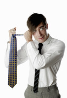 Businessman holding a tie