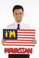 Businessman holding up an im malaysian
