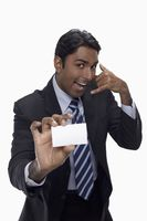 Businessman holding up his business card