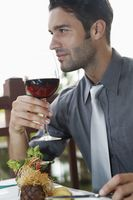 Businessman holding wineglass