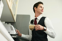 Businessman making coffee in the office pantry