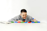 Businessman playing with plastic blocks