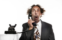 Businessman receiving a shocking phone call