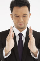 Businessman showing hand gesture