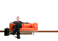 Businessman sitting on the couch with his legs crossed