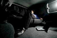 Businessman sleeping in the car