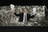 Businessman standing in a pile of paper clips