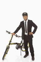 Businessman standing with a bicycle