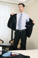 Businessman taking off his suit