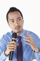 Businessman talking into the microphone