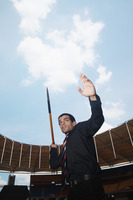 Businessman throwing a javelin