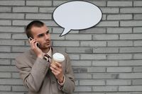 Businessman with speech bubble talking on the phone and holding a cup of coffee