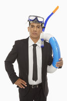 Businessman with swimming gear looking at the camera