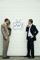 Businessmen analyzing stock market growth on television